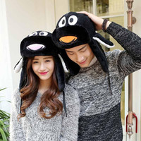 Wholesale 2 color Penguin Trapper Hats Ushanka Russian Hat Fur Winter Hats sports snow outdoor aviator ear flaps cap for Unisex Bomber Hats001