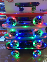 2 audio tables - 2015 LED Flash Kick scooters Mini bluetooth speakers wireless Subwoofer Stereo Portable Skateboard speaker for Table pc phone