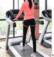 Wholesale Outdoor jogging leggings tight one yoga pants Korean fake two female quick drying pants fitness pants