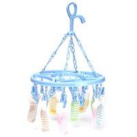 Wholesale 1pcs Hot Sale Practical design Plastic Drying Hanger Rack Laundry Hanging Sock Clothes Convenient