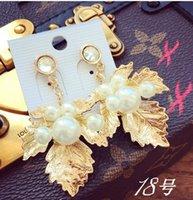 Wholesale gold leaf pearl women s earings xcdxl