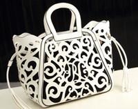 Wholesale Hot Casual New Spring women s handbag fashion cutout carved handbag shoulder bag Girls hollow package tassel bag