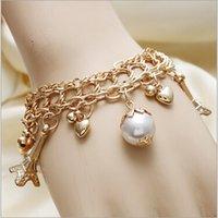 Wholesale 12PCs Fashion New Women Jewelry Pearl Pendant Alloy Eiffel Tower Decoration Cahin Bracelets Bangle
