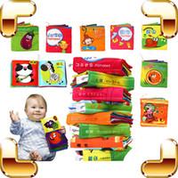Juguetes chinos de la nueva llegada España-Aprendizaje chino de la nueva de la llegada del bebé del regalo del libro del paño que aprende los juguetes de la historieta de los niños del juguete del libro del traqueteo del bebé