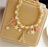 achat en gros de bracelets en cuir fleurs-Vente en gros-Les nouveaux bijoux à la mode en étoile tour de fleur cartes en cuir de corde Paris Tour Eiffel Couronne Bracelet