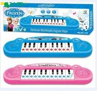 mejor juguete instrumentos musicales de precios congelados chica de dibujos animados teclado juguete órgano electrónico del bebé electrónica piano con música para niños