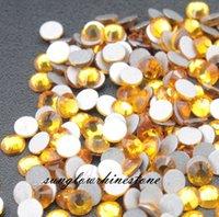 Wholesale crystal yellow rhinestone flat base DIY jewelry parts loose rhinestones per bag SS3 SS20