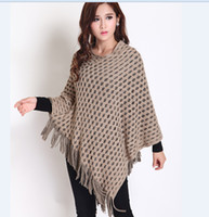 Wholesale Newest fashion batwing knit poncho shawl cape elegant women s hollow out fringed shawl sweater