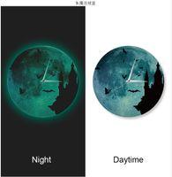 Wholesale DIY creative magic castle watches luminous watches mute luminous moon hanging Zhong Faguang silent wall clock