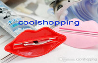Wholesale 300pcs DHL Multi Fuction Novelty Lip Kiss Press Tube Dispenser Squeezer Toothpaste Gadget
