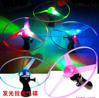 Wholesale 2015 LED Flash Pull luminous flying saucer led light UFO children Kids flying toys Night Glow led light toys colorful lights