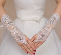 Wholesale Luxury Bridal Gloves Wrist Length Ringer Finger With Beads Elegant Lace Wedding See Through Women Gloves For Appliques