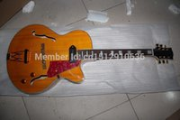Wholesale Chinese custom yellow tiger flame top hollow body jazz electric guitar