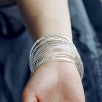 Wholesale 10 Top quality New arrive fashion women Bangles sterling silver bracelet color is gold and silver