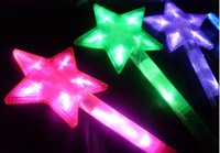 big four concert - A large five pointed star flashing colour our concert Four powder blue green yellow color random mix