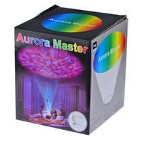 Wholesale 2015 hot Free DHL Mini Portable Romantic Aurora Master Colorful LED Light Projectors Speakers Ocean Wave Rainbow Projector Speaker Lamp