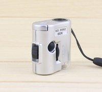 60X luz UV de la lupa 60X de bolsillo LED Multifuncional Microscopio portátil Lupa Lupas Mini lupa lupa Mini moneda Detector