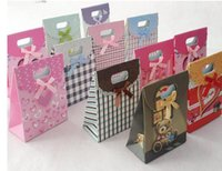 Wholesale New Arrive Stand up handle bag solid favor bags gift paper bags colorful thick and strong