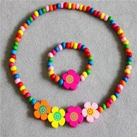 Wholesale Girl Necklace Children Toys Girl Necklace Suits Hot Children Four Flower Color Wood Bead Toys Baby Cute Flower Necklace Bracelet