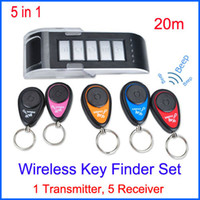 Wholesale Wireless Key Finder set Anti lost Alarm RF Wireless Electronic Finder Locator Key Chain Transmitter Receivers