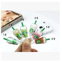 Wholesale Newest Cell Phones Plug Starbucks MM Universal Dust Plug Earphone Jack Plug Headset Stopper Cap For all cell phone Dhgate plug