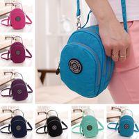 fashion fabric handbags - JINQIAOER Fashion Shoulder Bag for Women Waterproof Fabric Grab Handle Zip Closure Pocket Crossbody Bag Handbag Bolsa Feminina B0089