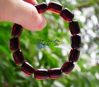Wholesale quot Recalling the ancient Church quot finished barrel blood amber natural amber beads bracelet