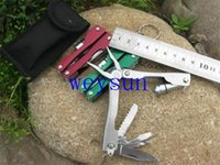 Wholesale DHL Freeshipping Outdoor Camping Sport Multi use Folding Hand Tool Sets LED Light pliers saw screwdriver knive survival hand tool