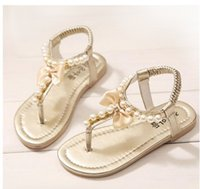 Precio de Sandalias de perlas flores-2015 de princesa Slip-On de la muchacha de las sandalias de la perla dulce de la flor dulce de las muchachas de la alta calidad que rebordea los zapatos de los niños 4 colores