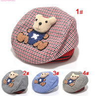 bear ear hats - 2015 Fashion Hot Sale Handsome Children Hats Lovely Bear Ear Muff For Baby Cotton Colourful Plaid Caps For Kids Four Colours CR272