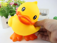 toy duck calls - Children take a bath toy Stand up little yellow duck Speak little yellow duck Paddle baby ducks Call voice is swimming beach toys