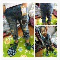 Wholesale Children s clothing autumn child retro finishing hole soft denim male female child denim trousers Children s Trousers