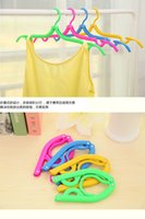 Wholesale Travel Essentials candy color portable folding hanger clothes rack hanger Tao same paragraph