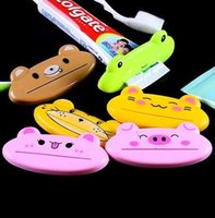 Wholesale Cute Cartoon bathroom accessories toothbrush holder products automatic toothpaste dispenser toothpaste squeezer household items