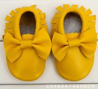 Wholesale hot selling autumn and winter fringed leather baby shoes Kids toddler shoes brand Moccasins lovely bow pairs