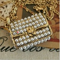 bag tin cans - Min order is can mix style Long section of hollow retro palace pearl necklace long sweater chain bags long for women