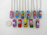 Wholesale The world s smallest four hole octave harmonica cartoon small mini harmonica harmonica Necklace