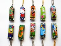 Cheap 2016 MUSIC-BOX Harmonica Four-hole 4 Tone Mini Harmonicas World's Smallest Harmonica Musical Instruments With Necklace Key Ring Key chain