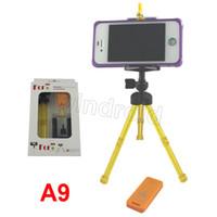 Wholesale Universal Mini Rotating Extendable Mini Tripod Stand Holder wireless Bluetooth Remote photo Camera Control Self timer Shutter