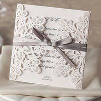 ribbon bow and flowers - The new in Europe and the hollow out flower ribbon bows wedding invitations wedding decorations
