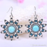 Wholesale Retro fashion carved hollow flower shaped Turquoise Earrings factory direct Europe and the United States major suit jewelry