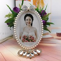 Wholesale European creative combination of inch pearl butterfly gold picture frame picture frame gifts home gifts photo frame studio swi