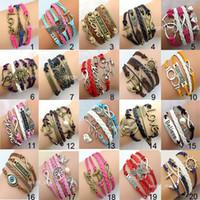 achat en gros de charmes de bronze infini-Perle Knitting Bracelet Bronze Fashion Infinity Bracelets Imité en cuir Vintage Jewelry série New Christmas 148 Designs DRB001