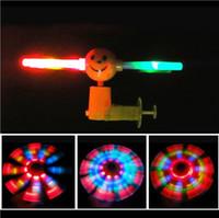 Wholesale 2015 Flash windmill music luminous LED windmill smiley hand push windmill puzzle toys children