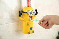 Wholesale Creative couple of small yellow cartoon automatic toothpaste dispenser package Doubtfire people wash toothbrush holder sucker LLFA4180F