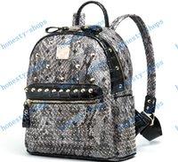 Wholesale Brand New MCM Korean star models new trend exo rivets python shoulder bag backpack school bag fashion handbags Serpentine bag color
