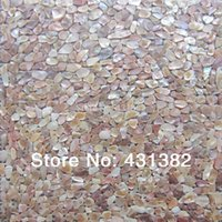 Wholesale Natural Mother of pearl shell mosaic tile irregular shape on mesh natural colour sea flower shell