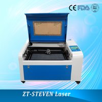 Wholesale 2016 hot sale w laser tube CO2 laser engraving machine with rotary for engraving glass rubber ect Skype stevenboolshi