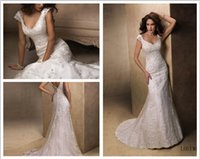 beaded lace motifs - Custom Made A line gown of tulle and beaded lace motifs features a soft V neckline Back cap sleeves Violet Wedding Dress