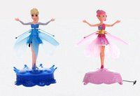 Wholesale 2014 Flying Infrared Induction LED Frozen Doll Frozen Princess Toys Theme Music Elsa Anna Dolls Toys Brinquedos Kids Girls with retail box